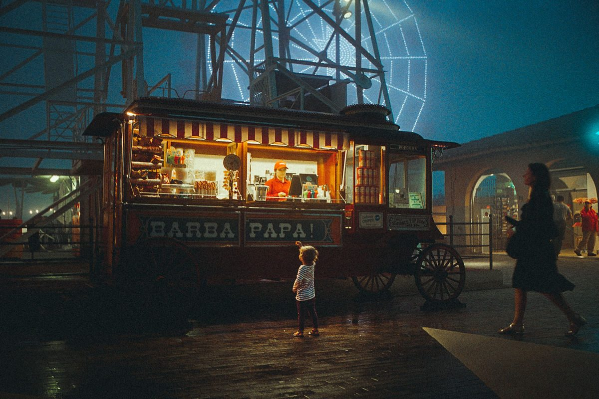 child in a luna park in the evening.