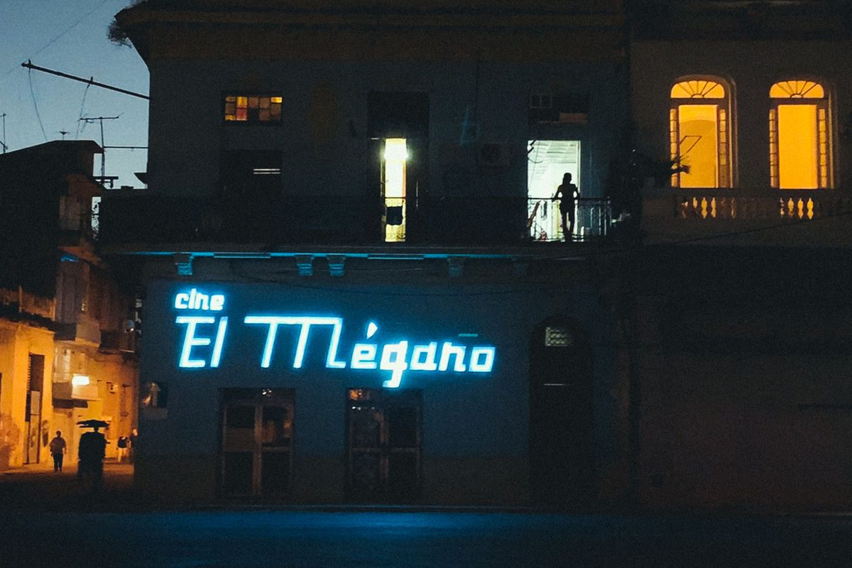 building with luminous sign at night.