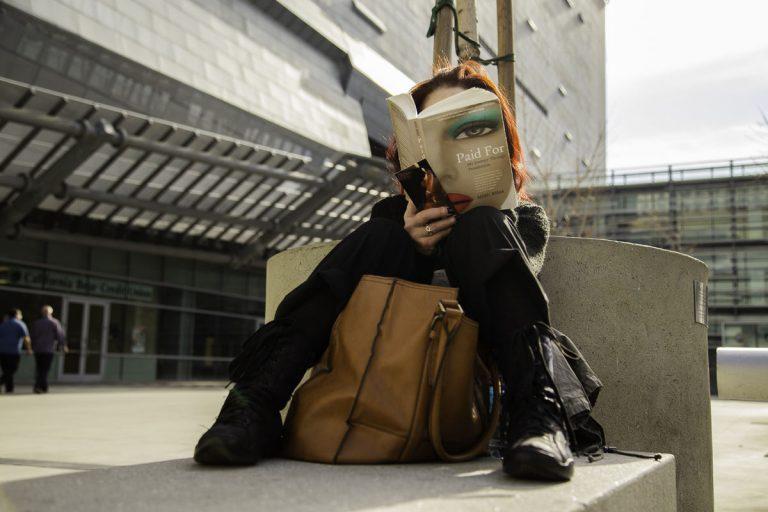 woman reads fashion magazine
