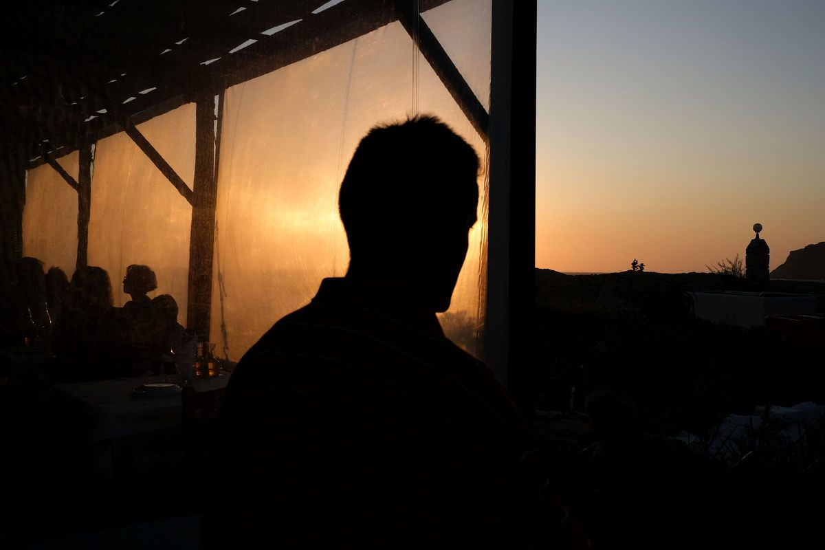 a man covers a sunset