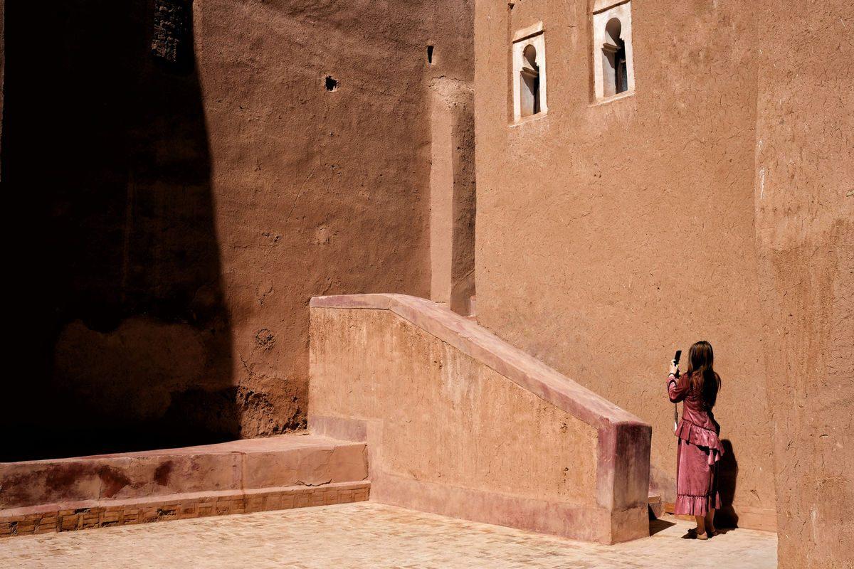 Luca Signorelli photography a woman photographs ancient walls