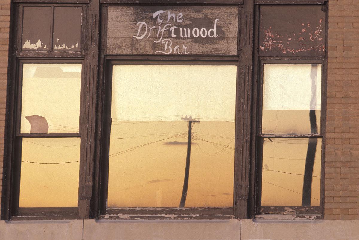 TomJenzDriftwoodBarwindow Street Photography
